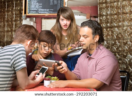 Rude diners ignoring waitress in a coffee house - stock photo
