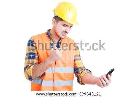 Rudeness and obscene gesture concept with young engineer or constructor showing middle finger at cellphone isolated on white - stock photo