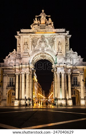 Rue Augusta arch in Commerce square at night. Lisboa, Portugal. On the arch the sculptures of Viriatus, Vasco da Gama, Pombal and Nuno Alvares Pereira - stock photo