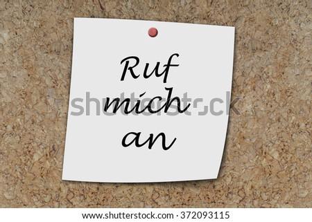 Ruf mich an (German Call me) written on a memo pinned on cork board - stock photo