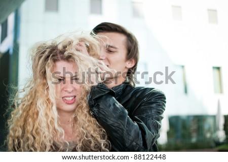 Ruffle hair - couple outdoors - stock photo