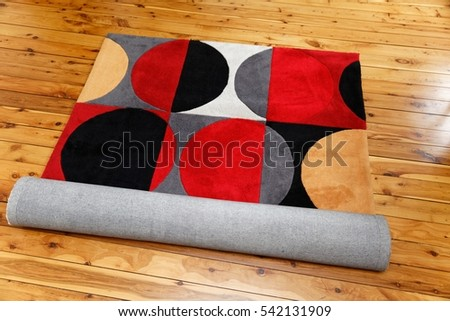 Rug with red and black circular patterns