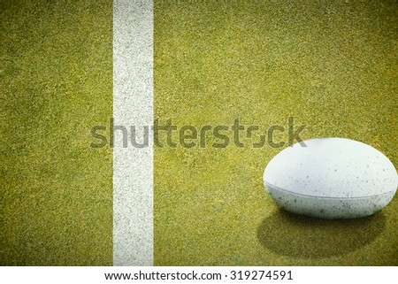 rugby ball against pitch with line