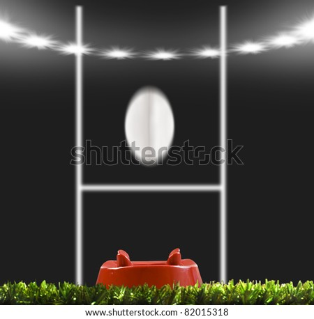 Rugby ball kicked to the posts on a rugby field - stock photo