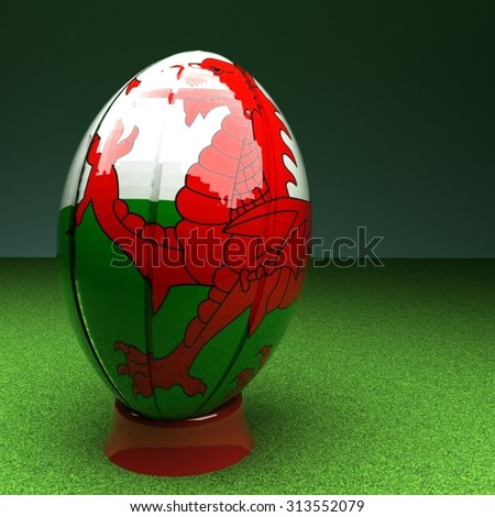 Rugby ball with Wales flag over green grass field, 3d render, square image - stock photo