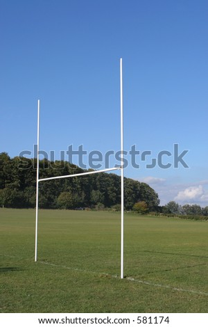 Rugby goal posts and field - stock photo