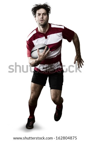 Rugby player in a red uniform running. White Background - stock photo