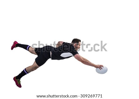 Rugby player scoring a try on white background - stock photo