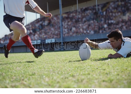 Rugby player taking a penalty kick - stock photo