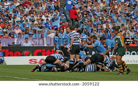 Rugby players in a loose scrum