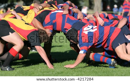 Rugby scrum at the senior club level in New Zealand.  Darfield v Kirwee on Kirwee's home field. - stock photo
