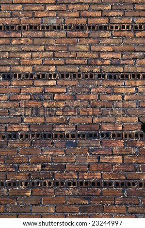 Rugged brick wall in an unfinished building - stock photo