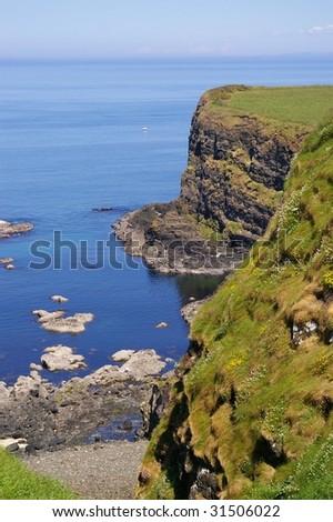 Rugged cliff coastline on Northern Ireland - stock photo