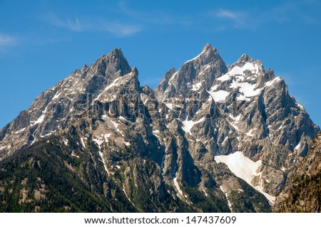 Rugged close-up of the Grand Tetons. - stock photo