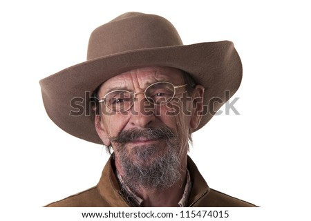 rugged elderly cowboy in studio on white background - stock photo