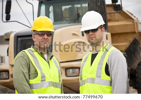 Rugged Male Construction Workers on the job - stock photo