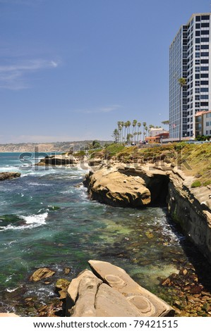 Rugged shoreline cliffs create beautiful scenic coves all along the waterfront in La Jolla, California. - stock photo