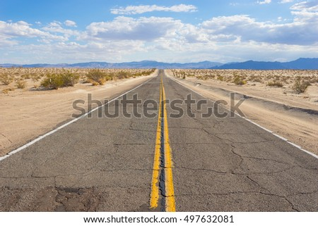 Rugged stretch of roadway in Mojave Desert of American southwest.