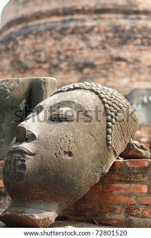 Ruin face of Buddha Wat Rajaburana (Ayutthaya, Thailand) - stock photo