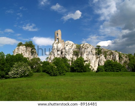 Ruin of castle on the cliff - stock photo