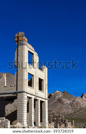 Ruined bank building in Rhyolite Ghost Town, Nevada, BLM owned - stock photo
