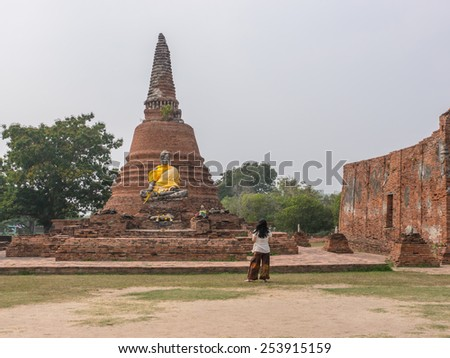 Ruined Buddha statue in ancient Buddhist temple in Thailand