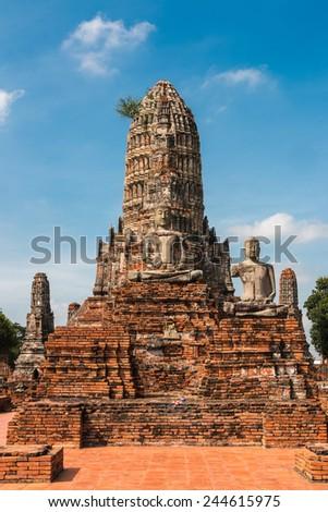 Ruined Buddha Statue, Wat Chai Wattanaram, at Ayutthaya Historical Park, Thailand - stock photo