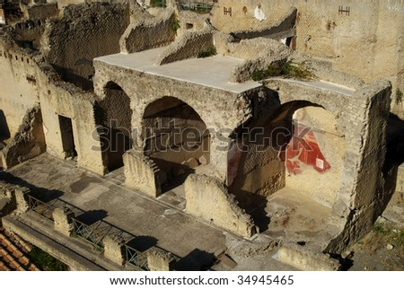 Ruined buildings line an ancient roman street, Herculaneum, Italy - stock photo