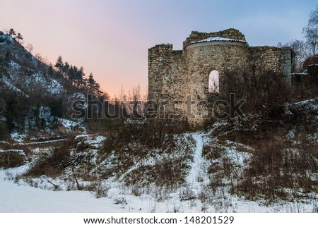 Ruined Byzantine church in snowy landscape of Bulgaria at sunset - stock photo