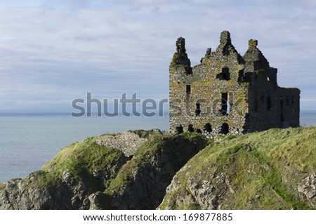 Ruined Castle looking out to sea on the cliffs on the west coast of Scotland. - stock photo