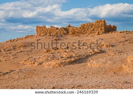 Ruined fort wall at Massada fortress in Negev desert, Israel - stock photo