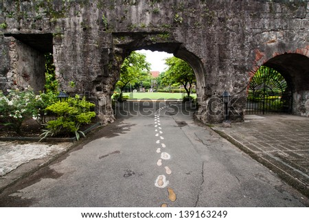Ruined gate in in Fort Santiago,  Intramuros district of Manil , Philippines. - stock photo