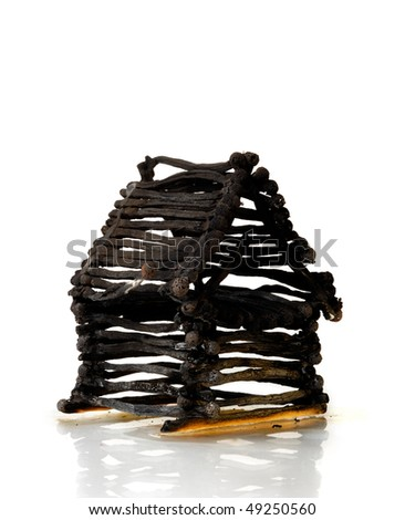 Ruined house from matches after fire Isolated on white background - stock photo