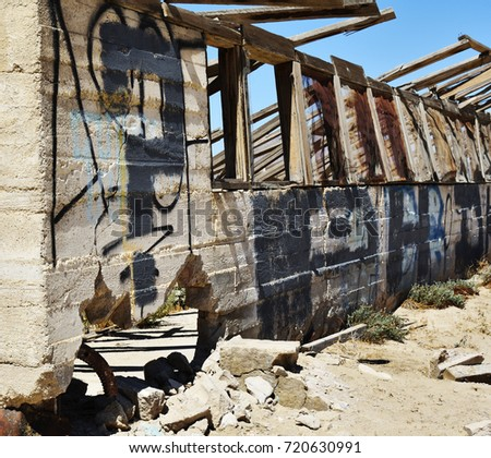 Ruined house in the desert. Decaying wood in the sun.