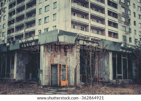 Ruined house with broken windows. The entrance, the exclusion zone, Pripyat, Chernobyl, Soviet architecture
