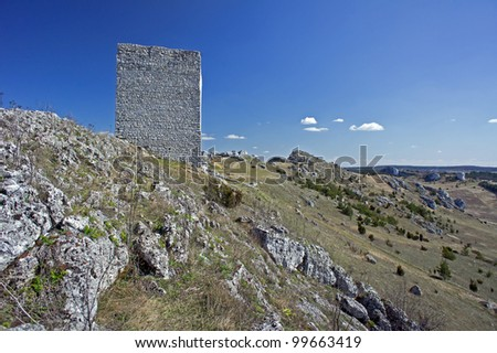 Ruined medieval castle with tower in Olsztyn, Poland - stock photo