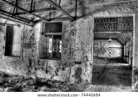 ruined old destroyed house, black and white - stock photo