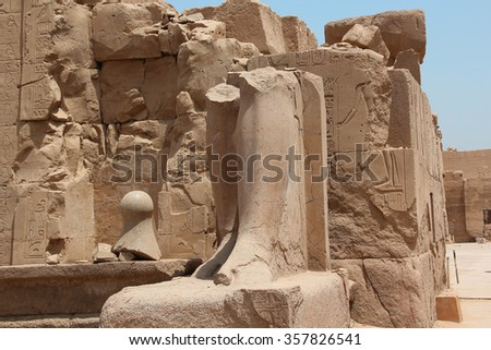 Ruined Stone legs and hat of pharaon at The Karnak temple in Luxor. Egypt