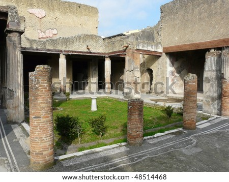 Ruined villa at the ancient Roman city of Herculaneum, which was destroyed and buried by ash during the eruption of Mount Vesuvius in 79 AD - stock photo