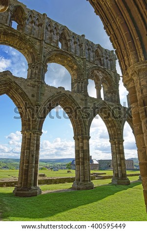 Ruined walls of Whitby Abbey in North Yorkshire in England. It is ruins of the Benedictine abbey. Now it is under protection of the English Heritage. - stock photo