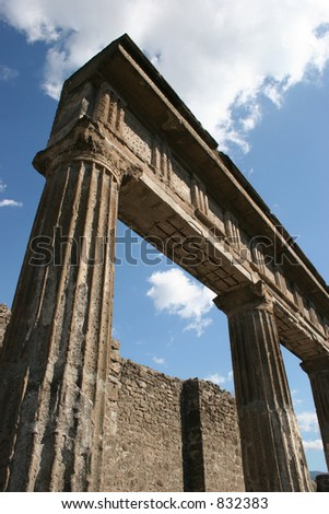Ruins and pillars at Pompeii, Italy.  Dates back to 79AD. - stock photo