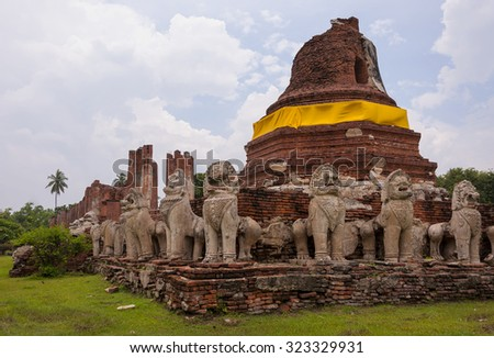 Ruins Buddha image, pagoda, monastery in ancient temple - stock photo