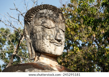 Ruins Buddha statue, pagoda, monastery in ancient temple, Kampangphet historical park,Thailand. - stock photo