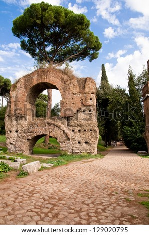 Ruins from Acquedotto Cladio and stone street in Palatine Hill at Rome - Italy - stock photo