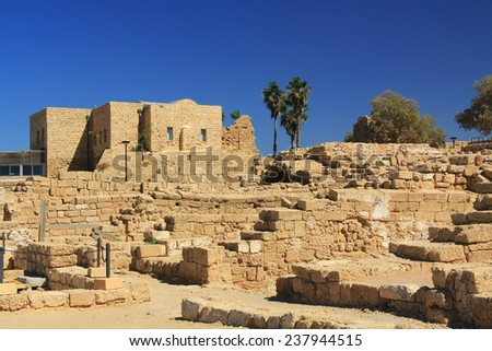 Ruins in Caesarea Maritima National Park, a city and harbor built by Herod the Great about 25-13 BC. The archaeological ruins are on the Mediterranean coast of Israel. - stock photo