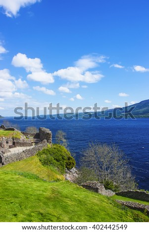 Ruins in Urquhart Castle in Loch Ness in Scotland. Loch Ness is a city in the Highlands in Scotland in the United Kingdom. - stock photo