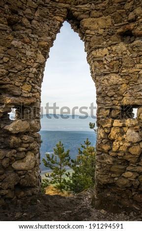 Ruins of a Castle on a Rockface in Gleissenfeld, Austria, Located in Nature Park Seebenstein-Turkensturz. - stock photo