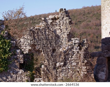 Ruins of a old abandoned stone house on a hill