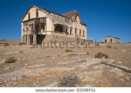 Ruins of abandoned houses in the ghost diamond town Kolmanskop near Lüderitz, Namibia, Africa