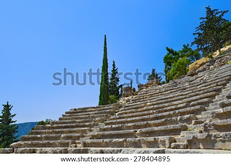 Ruins of amphitheater in Delphi, Greece - archaeology background - stock photo